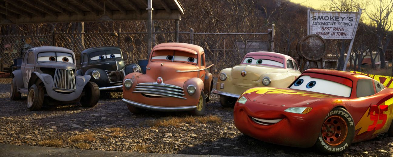 Lightning McQueen connects with racing's roots in Cars 3.  From left: River Scott, Junior MidnightMoon, Smokey and Louise BarnstormerNash.