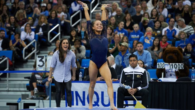Freshman Madison Kocian is one of three Olympic gold medalists that are currently part of the UCLA team. Kocian competed in 2016, while volunteer coach Jordyn Wieber (in the background) and fellow freshman Kyla Ross were on the 2012 Olympic team.