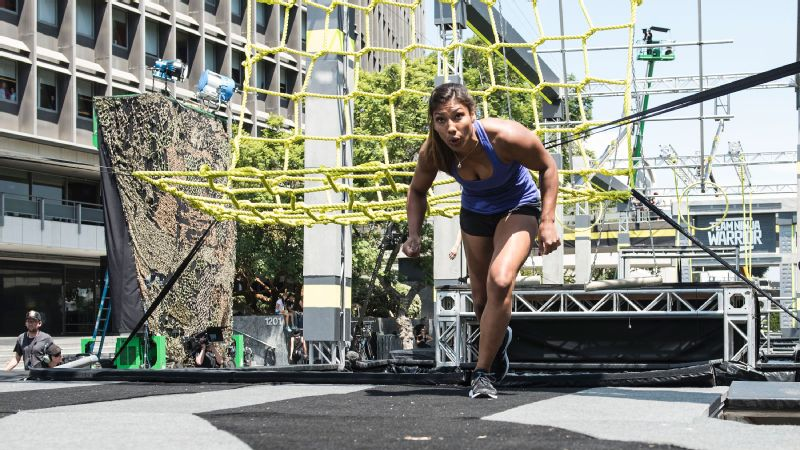 Captain of the Mega Crushers, Meagan Martin competes on this year's Team Ninja Warrior course. She is one of three female captains this season.