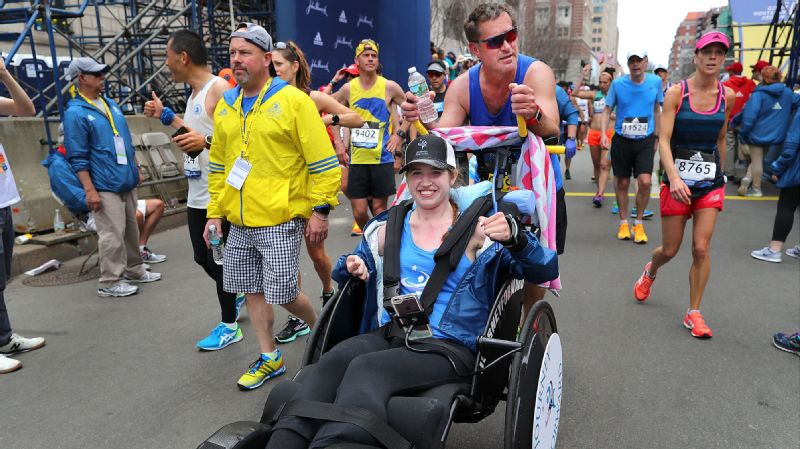Bobby Carpenter pushes Denna Laing over the finish line of the Boston Marathon on April 17, 2017. Lang suffered a spinal injury playing hockey in the Winter Classic at Gillette Stadium in 2015.