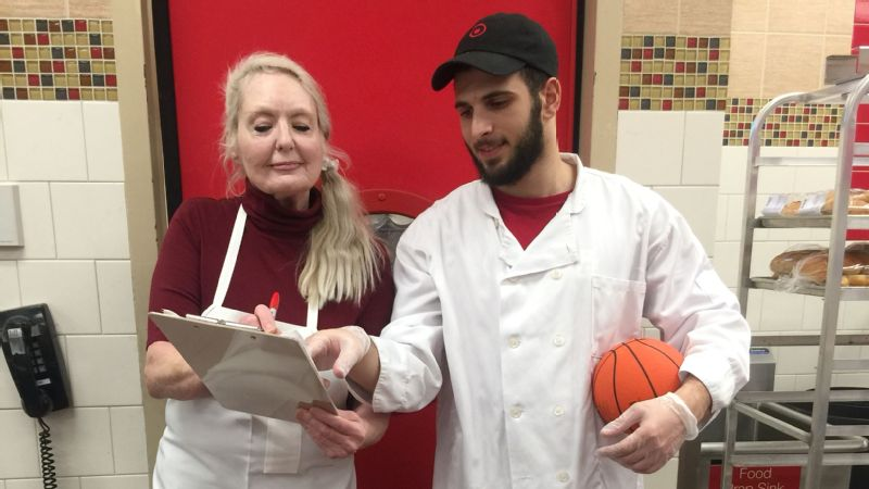 Mohammed Jaljouli was surprised when his co-worker, Adele Walters, brought handwritten notes from watching a basketball game on TV. That's when he knew she was seriously interested in learning more about the sport.