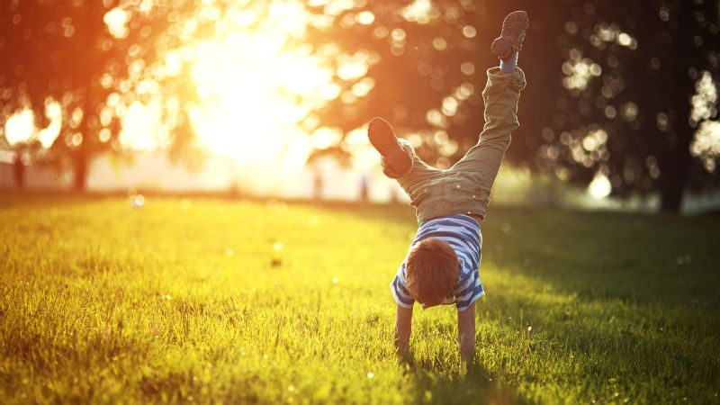 Kid doing cartwheel