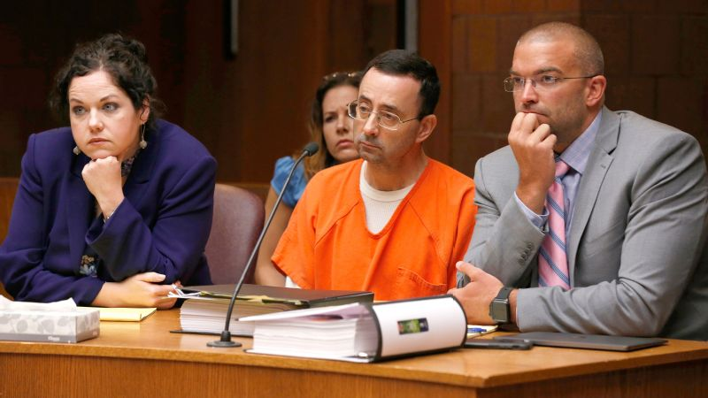 Former Michigan State University and USA Gymnastics doctor Larry Nassar, center, with defense attorneys Shannon Smith, left, and Matt Newberg, right, in the 55th District Court on June 23.