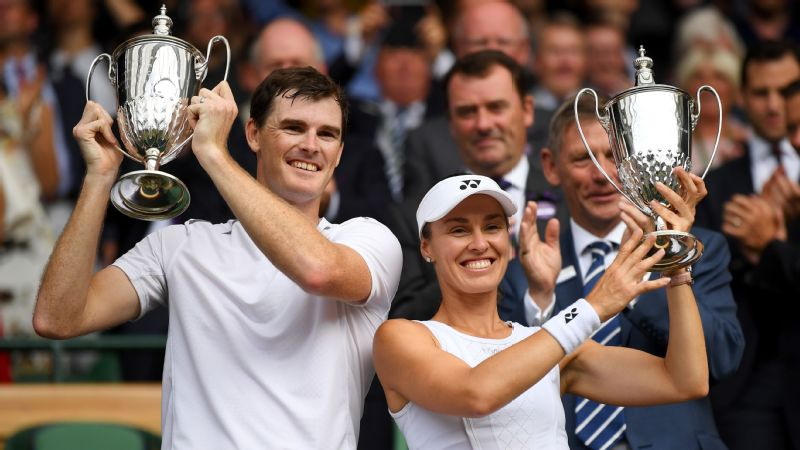 Jamie Murray of Great Britain and Martina Hingis of Switzerland celebrate victory with their trophies after the Mixed Doubles