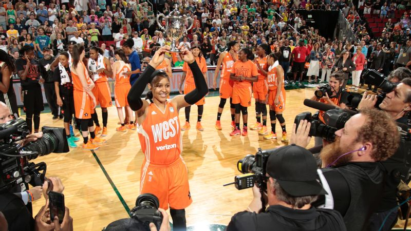 Maya Moore holds up the MVP trophy after scoring 23 points in the WNBA All-Star Game.