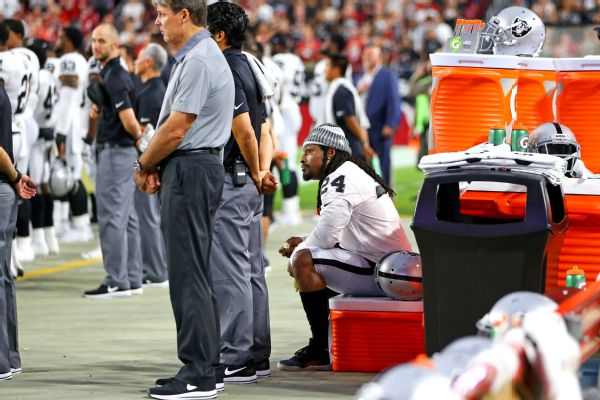 Raiders RB Lynch sits during national anthem