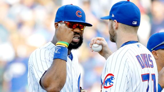 Jason Heyward #22 of the Chicago Cubs (L) and Wade Davis #71