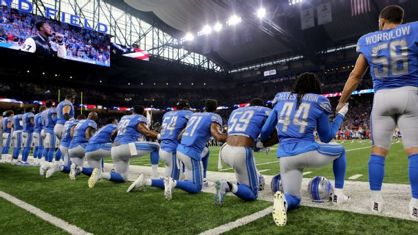 Members of the Lions take a knee during the playing of the national anthem before a game in September.