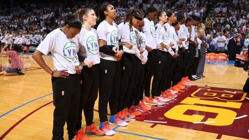 The Minnesota Lynx stood with their arms locked during the national anthem before Game 1 of the WNBA Finals.
