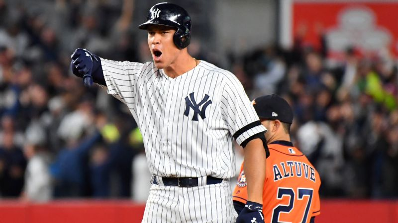 Aaron Judge gives the Yankees' signature thumbs down celebration to the dugout after his game-tying RBI double.