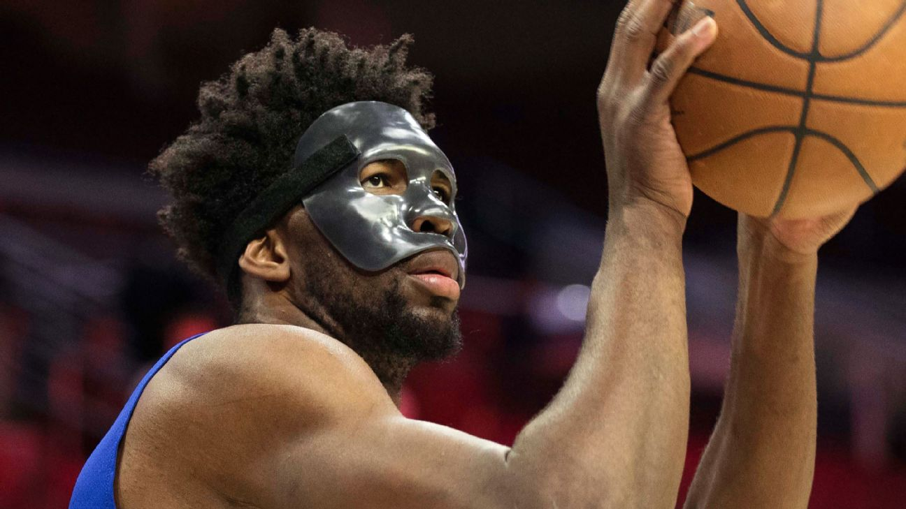 Joel Embiid wears striking mask courtside, goes through ...