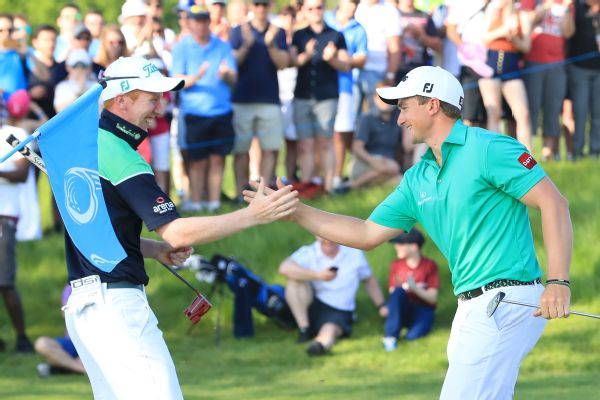 Paul Dunne of Ireland and Gavin Moynihan of Ireland (L) celebrate winning the final match during day two of the GolfSixes at The Centurion Club