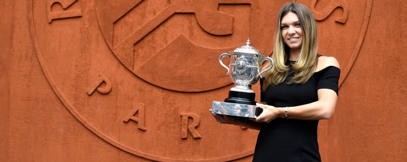 Romania's Simona Halep poses with The Suzanne Lenglen Cup