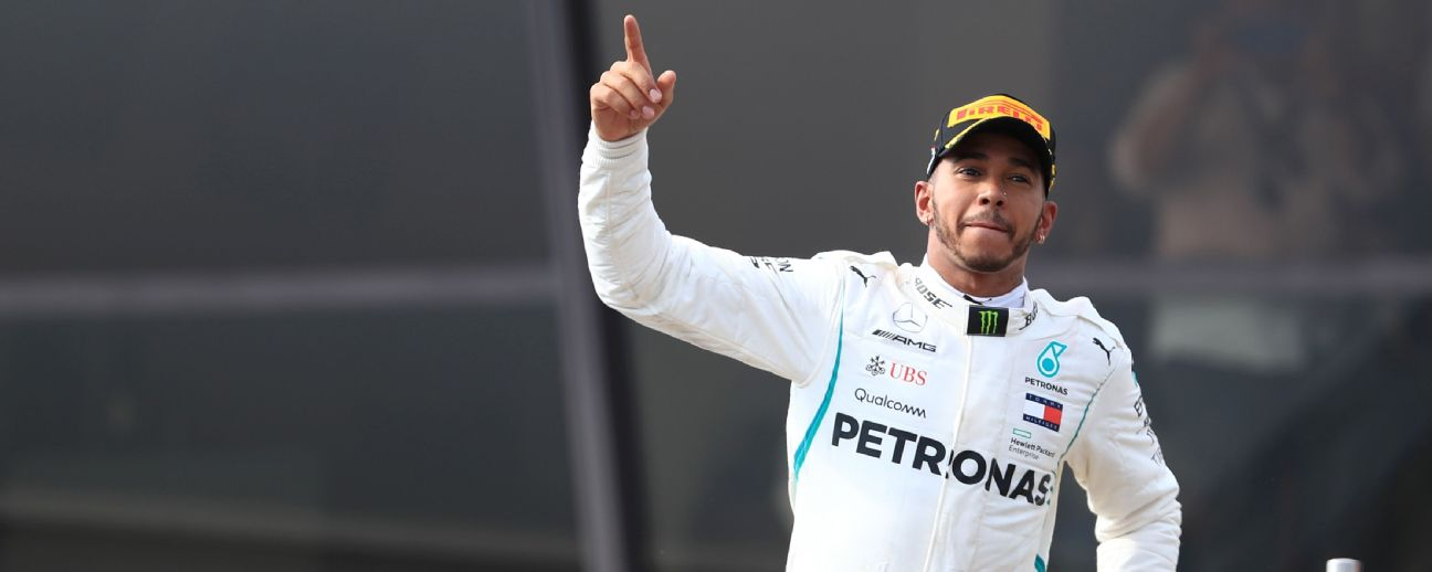 Lewis Hamilton celebrates on the podium after winning the French Grand Prix.
