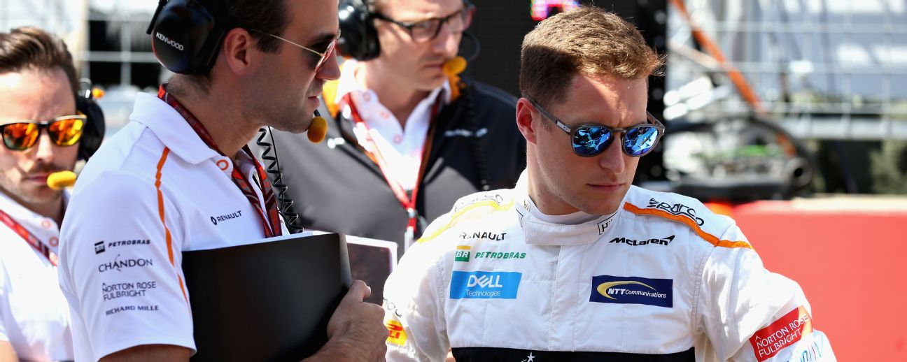 Stoffel Vandoorne of Belgium and McLaren F1 talks with his engineer Tom Stallard on the grid before the Formula One Grand Prix of Austria.