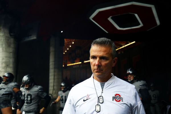 Ohio State coach Urban Meyer is on paid administrative leave pending the results of the investigation into the handling of Courtney Smith's allegations against Meyer's former assistant, which the university hopes to be done with in two weeks.