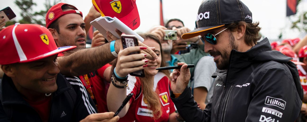 Fernando Alonso of Spain and McLaren F1 arrives at the circuit and signs autographs for fans before the Formula One Grand Prix of Italy at Autodromo di Monza.