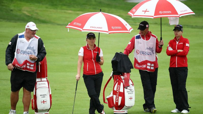 The rain from Typhoon Kong-rey soaked the course and the golfers, but Bronte Law (second left) and Jodi Ewart Shadoff (right) are leading Team England as play was suspended on Friday.