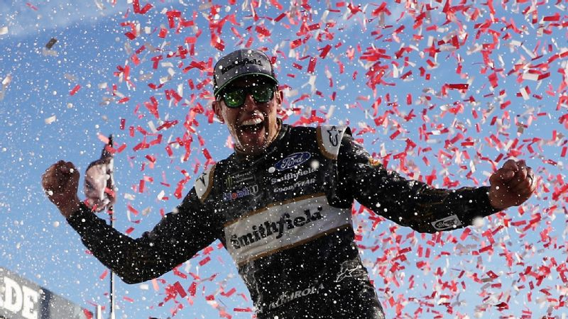 Aric Almirola celebrates in Victory Lane after winning the Monster Energy NASCAR Cup Series 1000Bulbs.com 500 at Talladega Superspeedway on October 14, 2018.