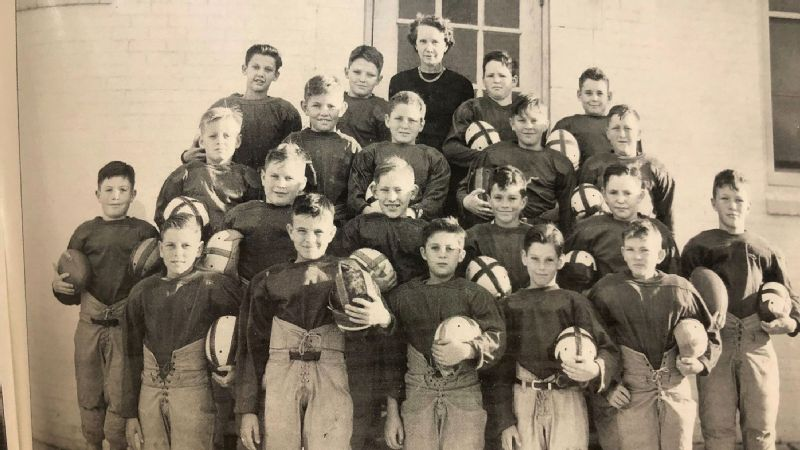Coach Tylene Wilson with one of her football teams in Brownwood, Texas. Circa 1943.