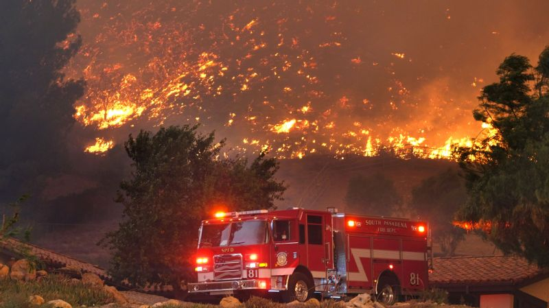 Firefighters from various departments worked to protect structures as the Woolsey Fire moved through Southern California.