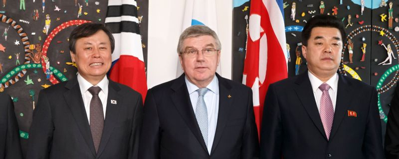 IOC President Thomas Bach alongside the sports ministers of the North and South Korea at a meeting to discuss a bid to co-host the 2032 Summer Olympics in Lausanne, Switzerland -- Feb. 15 2019.