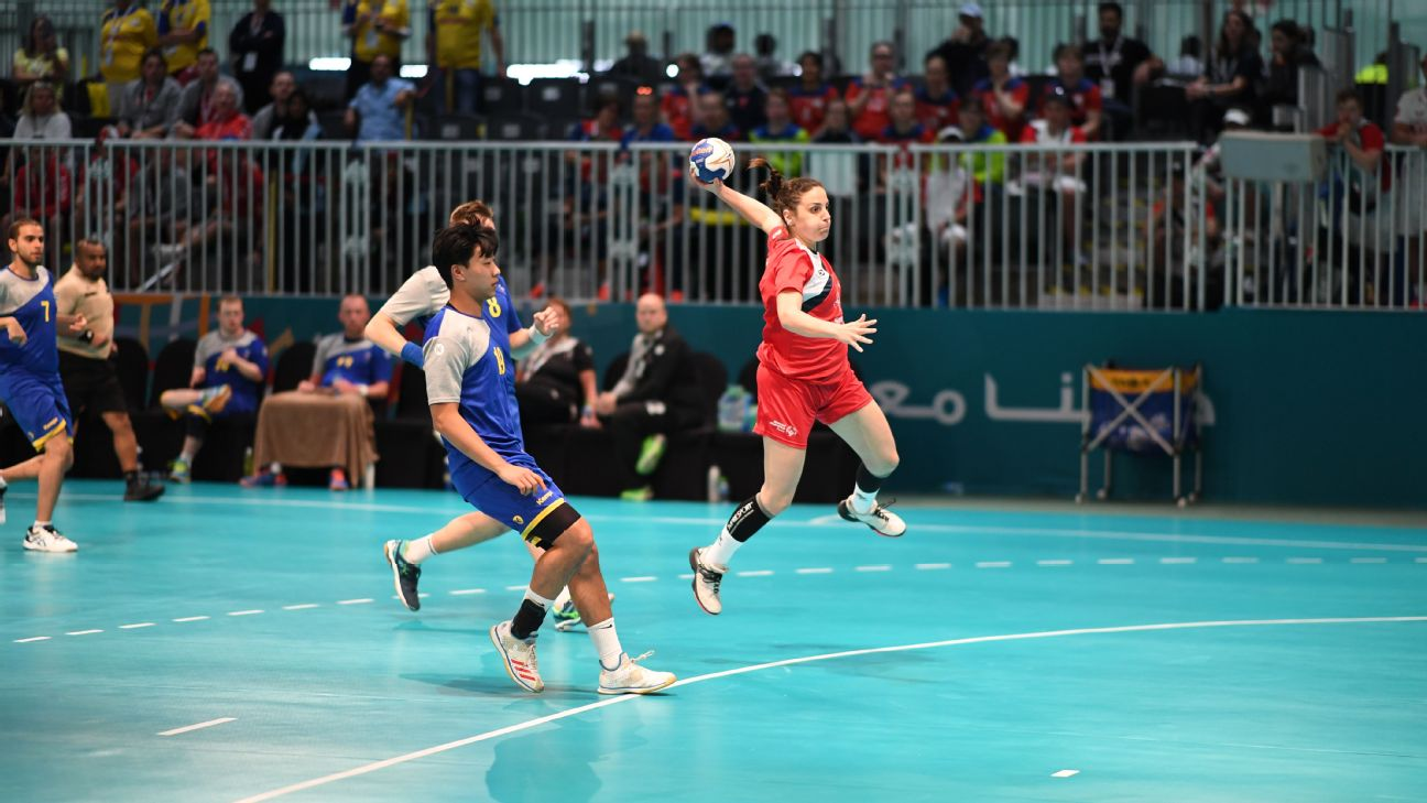 The heat is on during this handball game in Abu Dhabi between Estonia and Sweden.