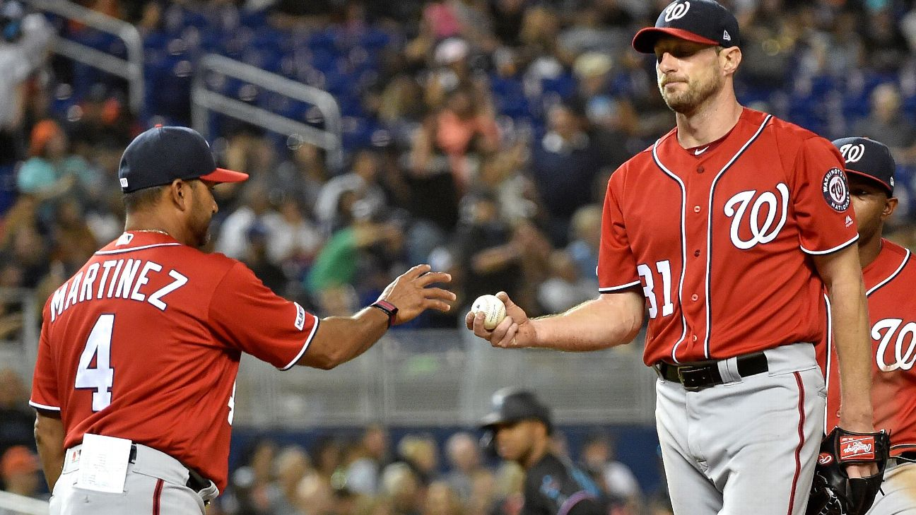 Washington Nationals manager Dave Martinez takes starting pitcher Max Scherzer out of the game in the sixth inning.