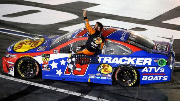 Martin Truex Jr. celebrates winning his second Coca-Cola 600 in four seasons.