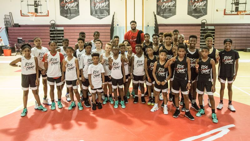 Los Angeles Lakers star Anthony Davis stands alongside students of the week-long Nike Rise basketball camp in Chicago. The hometown hero schooled the 8-17-year-olds on ball handling and more.