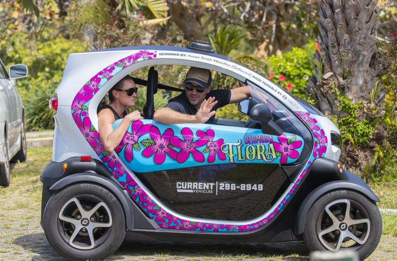 Flora Duffy and her husband Dan Hugo navigate the narrow streets of Bermuda in a Twizy electric car.