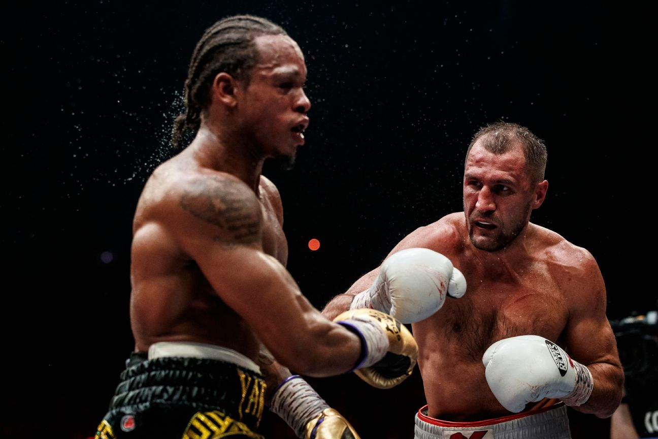 Boxers Sergey Kovalev of Russia, right, and Anthony Yarde of Britain exchange blows during their WBO light heavyweight title bout in Chelyabinsk, Russia, Saturday, Aug. 24, 2109.
