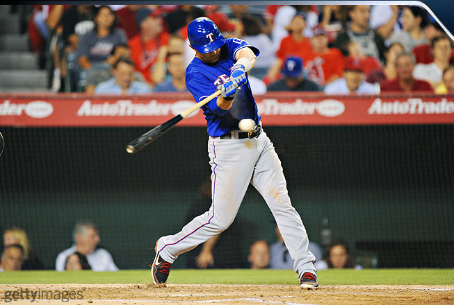 Young drives his back knee toward his front knee and gets good hip turn as he brings the bat head down to the ball. He's in a balanced posture at the point of contact.