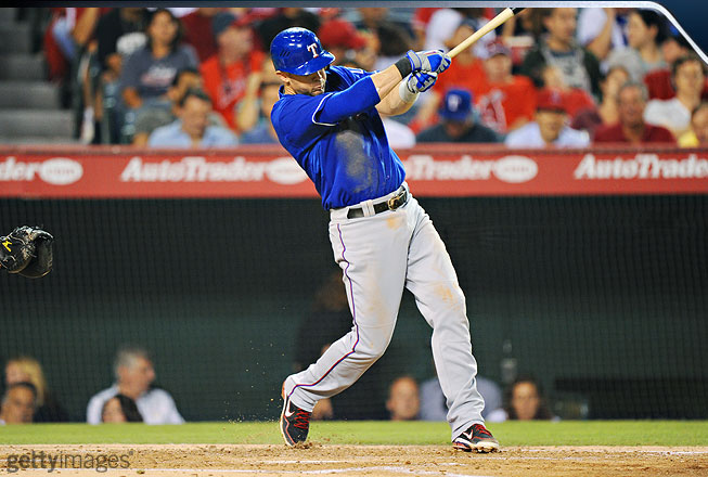 As Young begins to follow through, he gets full extension with the bat, which travels up over his back shoulder. His back foot is up on its toes, which enables him to unleash his hips and finish with authority.