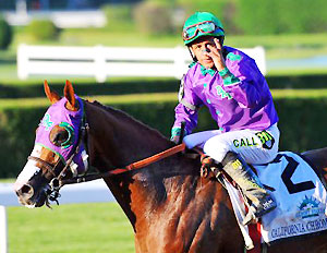 California Chrome and jockey Victor Espinoza after the 146th Belmont Stakes.