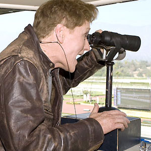 Late-night TV host Conan O'Brien takes in the view of a race caller.