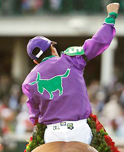 Victor Espinoza celebrates after riding California Chrome to victory in the 140th Kentucky Derby.