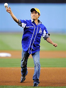 Kentucky Derby-winning jockey Mario Gutierrez throws out the first pitch prior to the Dodgers' game against the Giants.
