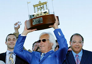 Trainer Bob Baffert, center, owner Ahmed Zayat, right, and his son Justin Zayat, left, celebrate after American Pharoah's runaway victory in Sunday's Haskell.
