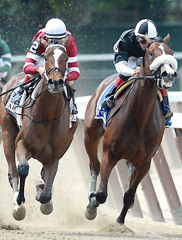 Untapable, left, wins the 2014 Mother Goose Stakes.
