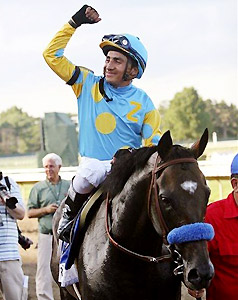 Jockey Rafael Bejarano celebrates after Paynter's Haskell victory.