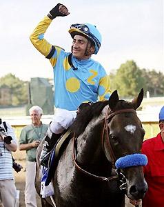 Jockey Rafael Bejarano celebrates after Paynter's Haskell victory.
