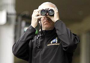 Trainer Todd Pletcher watches his trainees work at Churchill Downs on April 29, 2013.
