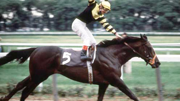 Seattle Slew wins the 1977 Triple Crown.