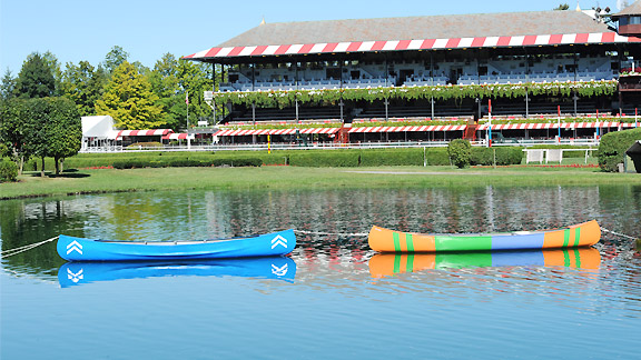 The colors of Godolphin (left) and Magic City Thoroughbred Partners share the infield pond at Saratoga after their horses finished in a dead heat in the Travers Stakes.