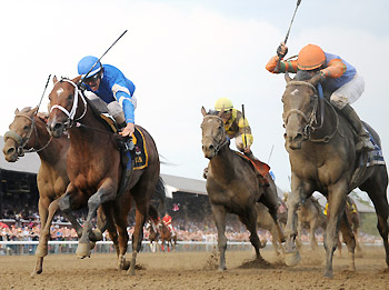 Golden Ticket (inside) and Alpha (blue cap, outside) hit the wire together to win the Travers.