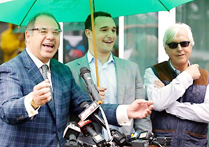 Ahmed Zayat, left, owner of Kentucky Derby and Preakness Stakes winner American Pharoah, his son Justin Zayat, center, and trainer Bob Baffert talk to reporters at Belmont Park on Tuesday.