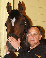 Empire Maker with trainer Bobby Frankel after 2003 Belmont Stakes.