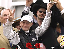 Calvin Borel celebrates his Kentucky Derby win on Mine That Bird.