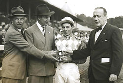 Trainer William C. Winfrey (left), owner Alfred Vanderbilt, jockey Eric Guerin and presenter F. Skiddy von Stade (right) in the winner's circle.